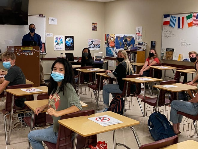 Students and educators in the Bastrop school district are shown wearing face coverings and observing other safety measures implemented to mitigate the spread of COVID-19. The Bastrop school board on Tuesday night voted unanimously to remove the district's face covering requirement, effective June 1.
