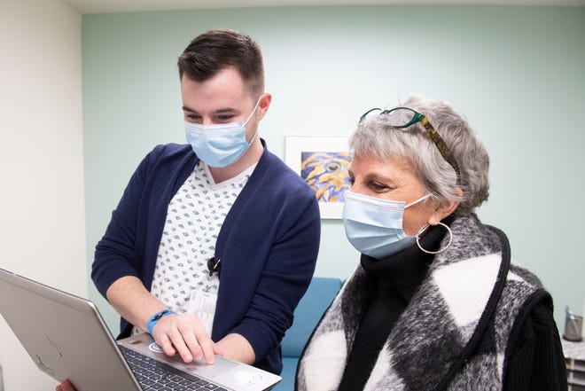 Pediatric psychologist Dr. Laura Gerak (right) reviews a patient case with mental health therapist Andrew Dodson. They are two members of the team in Akron Children's Lois and John Orr Family Behavioral Health Center at Akron Children's Hospital.