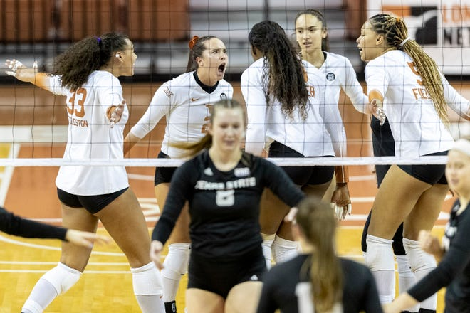 Texas players celebrate a point during Monday night's 25-19, 25-18, 25-18 sweep over Texas State at the Erwin Center. The second-ranked Longhorns improved to 18-0.