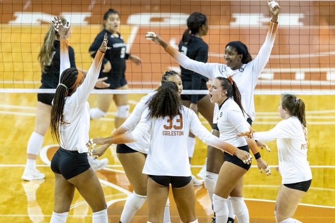 Texas celebrates a point against Texas State during a match in Austin in March. The Longhorns defeated Penn State in four sets to advance to the regional final of the NCAA Tournament. They'll face Nebraska on Monday.