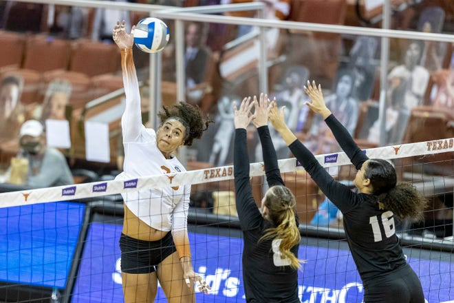 Texas outside hitter Logan Eggleston, hitting past Texas State middle blocker Jillian Slaughter, center, and outside hitter Janell Fitzgerald during teams' match earlier this month, led the Longhorns with 14 kills in Tuesday's 3-0 sweep of the Bobcats.