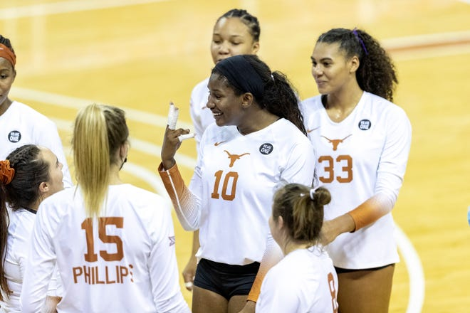Texas middle blocker Brionne Butler, center, had a big night for the Longhorns in their second-round win over Wright State in the second round of the NCAA Tournament on Thursday: she posted a near perfect hitting percentage— eight kills on nine attacks— and recorded five blocks.