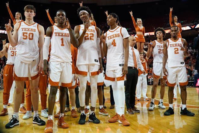 "Texas men's basketball players stand for the playing of ""The Eyes of Texas"" after their Jan. 18, 2020 game against Kansas at the Erwin Center. The school song is commonly played after UT sports events."