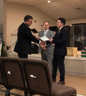 Rev. Dr. Tommy Kelly, at left, and church official Chris Mills, center, present Brice Noll with his certificate of ordination at Varnville First Baptist Church.