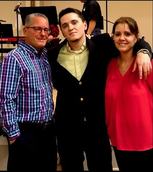 Brice Noll, center, with his parents, Doug and Kim Noll.