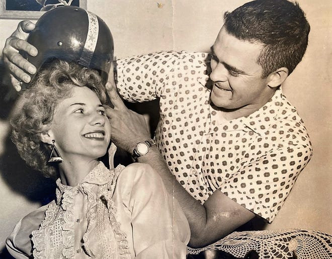 Theresa Ann Morgan jokes with her husband, Carl, before her parachute jump at an Augusta racetrack, which proved fatal.