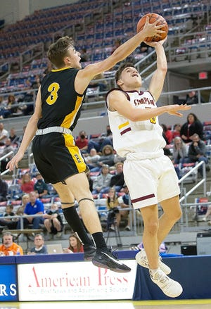 Simpson's Chris Vargas is rejected by Hornbeck's Jaren Mitcham (3) during action Monday in the Class C semifinals in Lake Charles. But it was Vargas and the Broncos which would prevail, 58-57.