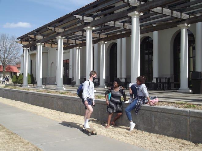 Students enjoy the beautiful weather at Oklahoma Wesleyan University on March 9, 2021.