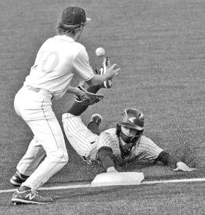 Bartlesville High third baseman Hayden Catlin, left, waits for the ball while a Broken Arrow High baserunner touches the bag.