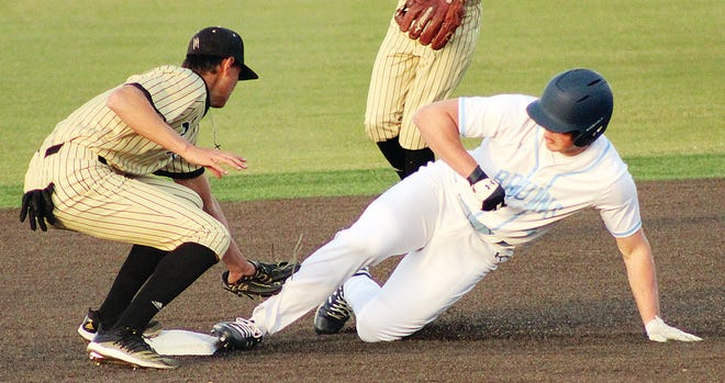 Bartlesville High baserunner Braeden Winters, right, is barely tagged out on a play at second during Monday's home battle against Broken Arrow High.