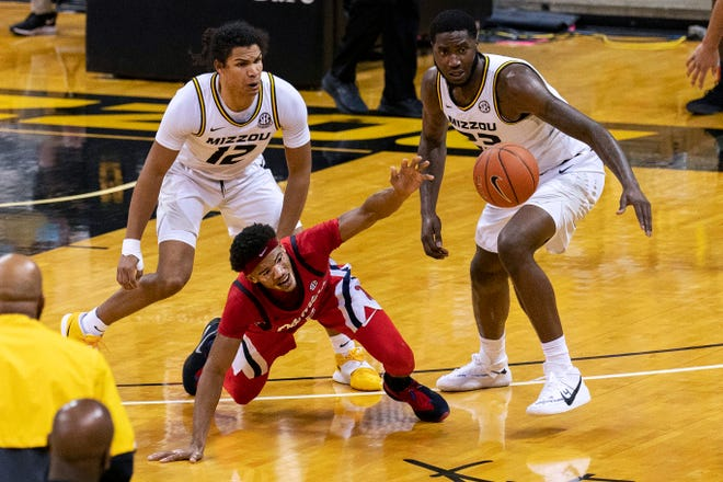 Mississippi's Devontae Shuler, center, loses the ball between Missouri's Jeremiah Tilmon, right, and Dru Smith during a game Feb. 23 at Mizzou Arena.