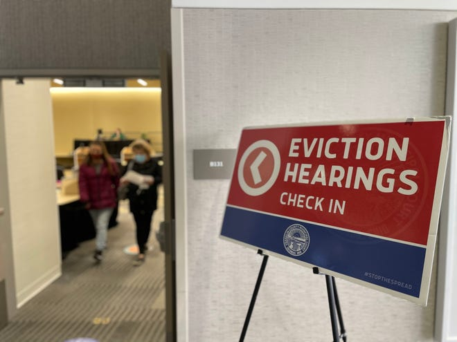 A sign points tenants and landlord to the temporary eviction courtroom at the Greater Columbus Convention Center Downtown on March 3, 2021.