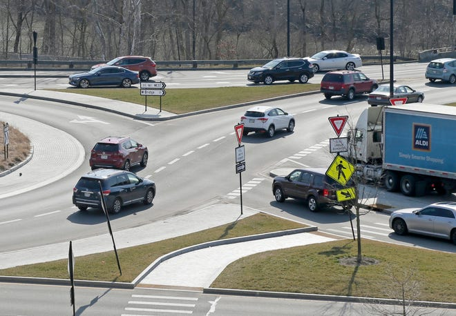 Drivers navigate through the roundabout at Rt. 161 and Riverside Drive near the new Market Street development in Dublin Monday.
