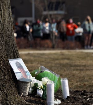 A makeshift memorial for Stone J. Foltz, 20, of Delaware, Ohio, is outside of Pi Kappa Alpha at Bowling Green State University where BGSU students gathered for a protest on Tuesday, March 9, 2021. Foltz died Sunday, three days after an alleged off-campus hazing incident.THE BLADE/AMY E. VOIGT