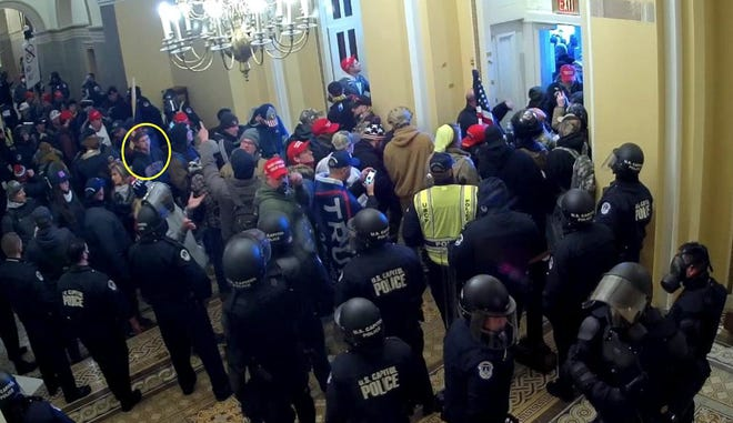 Image taken from U.S. Capitol security footage and filed in U.S. District Court for the District of Columbia that investigators say shows Jared Hunter Adams, 26, of Hilliard, entering the Capitol on Jan. 6.