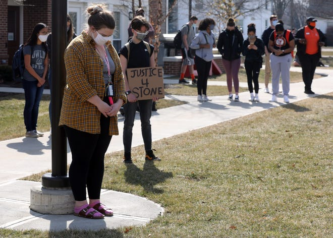 Bowling Green State University students hold a moment of silence for Stone Foltz on March 9.