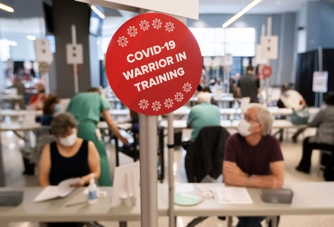 Patients receive COVID-19 vaccines at the mass vaccination facility inside Ohio State University's Schottenstein Center in Columbus on Tuesday, March 9, 2021.