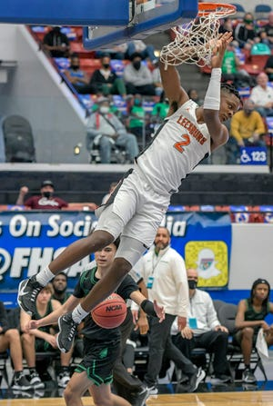 Leesburg's Camerin James (2) dunks the basketball in the Class 5A state semifinals against Fort Walton Beach Choctawhatchee High School at the RP Funding Center in Lakeland. James is the Daily Commercial All-Area Boys Basketball Player of the Year. [PAUL RYAN / CORRESPONDENT]