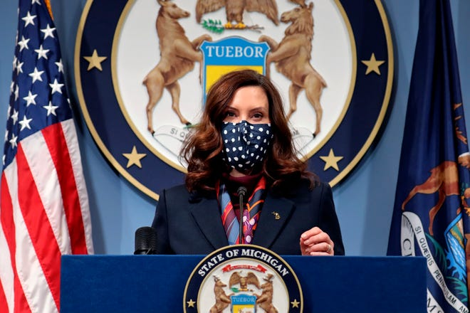 In a photo provided by the Michigan Office of the Governor, Gov. Gretchen Whitmer addresses the state during a speech in Lansing, Tuesday, March 2.