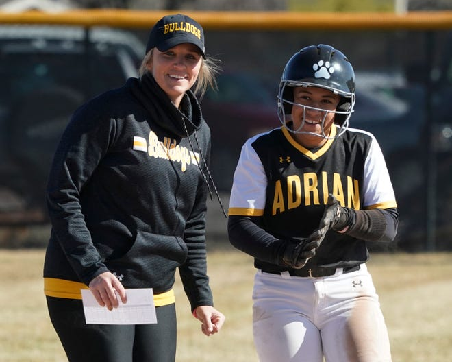 Adrian College head coach Ashley Skelly talks to Infinity Rogers during a game in the 2019 season.