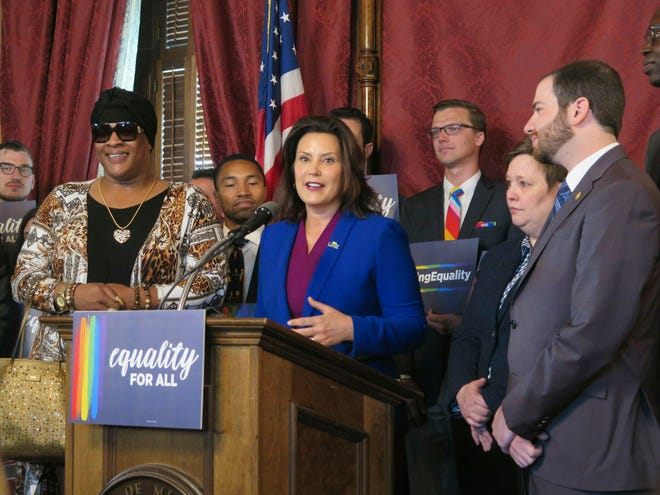 In this June 4, 2019, file photo, Michigan Gov. Gretchen Whitmer, center, joins with lawmakers and others in the Capitol building in Lansing, calling for expanding the state's civil rights law to prohibit discrimination against LGBT people. LGBTQ protections will be added to state civil rights law either by the legislative process or Michigan voter approval, two state legislators vowed Monday, March 8.