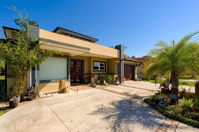 This unique custom ''green home'' in Palm Coast has been upgraded in every aspect.