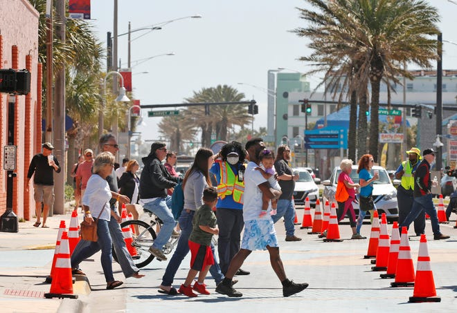 Pedestrians cross Atlantic Avenue in Daytona Beach, Tuesday, March 9, 2021.                                                                                                Pedestrians cross Atlantic Avenue in Daytona Beach, Tuesday, March 9, 2021.                                   A group of people walk across Atlantic Avenue in Daytona Beach during Bike Week earlier this month. A new report shows Florida to be among the most dangerous states for pedestrians, but also shows the state's pedestrians deaths were down 14% in the first six months of 2020 as compared with the same time in 2019.