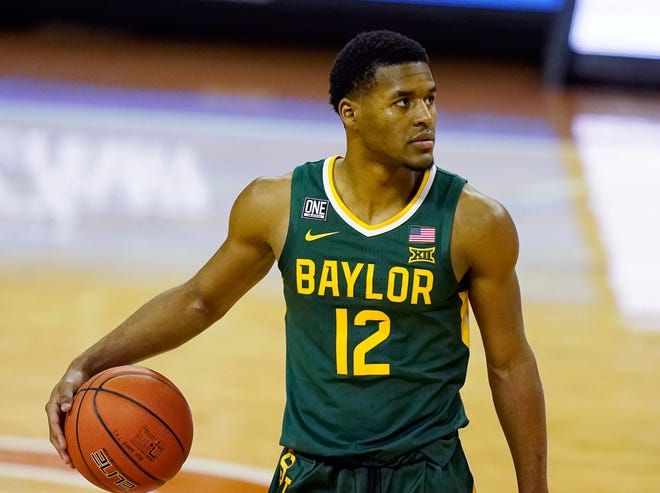 Baylor guard Jared Butler controls the ball during a game at Texas earlier this season. Butler is The Associated Press Big 12 men's basketball player of the year and a member of the All-Big 12 first team, announced Tuesday.