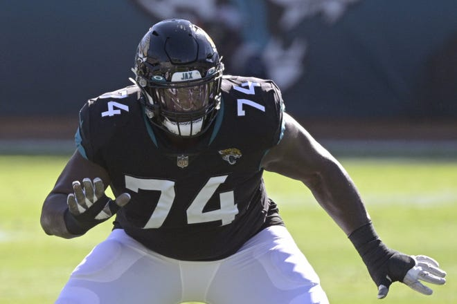 Jaguars' offensive tackle Cam Robinson (74), seen here setting up to block against the Chicago Bears in December, got the franchise tag Tuesday because the organization didn't feel strongly about other potential options at left tackle.