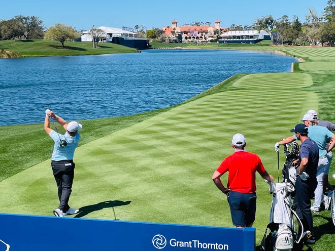 Tom Lewis hits his tee shot at the 18th of the Players Stadium Course at TPC Sawgass on Tuesday during a practice round with Cameron Smith and Charl Schwartzel. The Players Championship begins on Thursday.