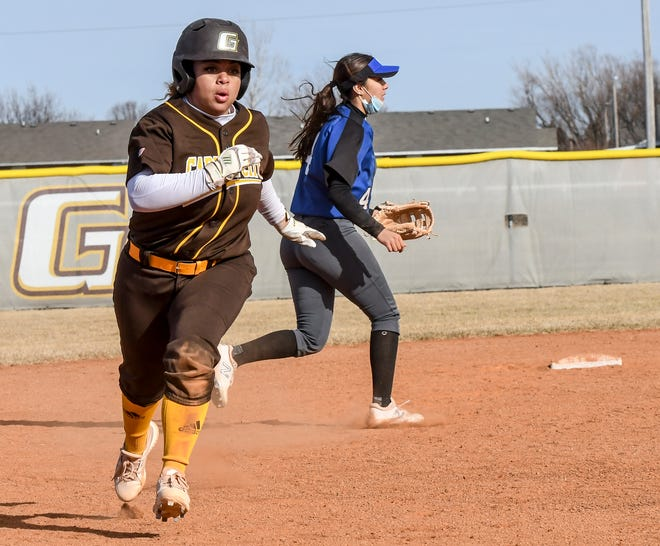 Garden City Community College's Elycia Johnson runs to third base off a sacrafice grounder by Nya Chacon to advance her during a February game against Lamar at Tangeman Sports Complex.