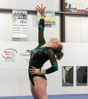 Evie Wilson is all smiles at the end of her floor routine.