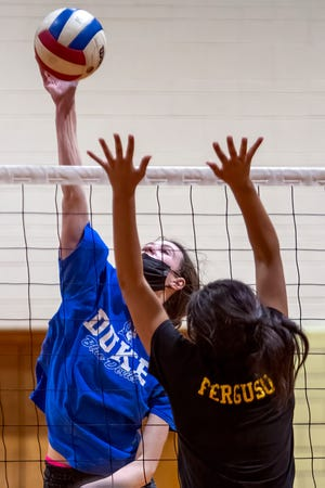Galesburg High School senior Audree Peck spikes the ball during the Silver Streaks' volleyball practice on Monday night at Churchill Junior High School.