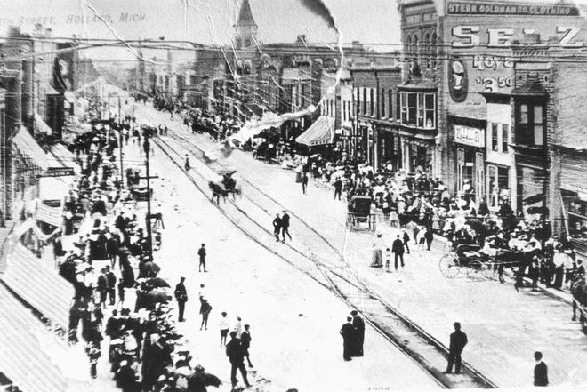 A look at early life in Holland on Eighth Street at River Avenue. People moved throughout the community on foot or in carriages prior to the advent of the automobile.