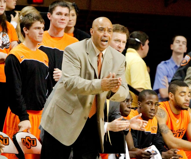 Oklahoma State assistant Chris Ferguson encourages his players during a 2009 game.