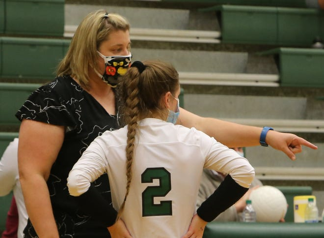 East Henderson volleyball coach Sabrina Cairnes talks with Emma Gilliam during a match earlier this season at East. [DEAN HENSLEY/ TIMES-NEWS]