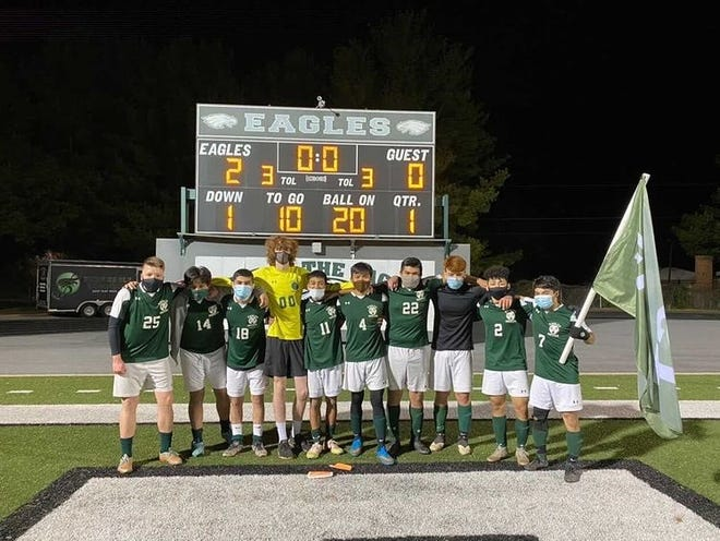 East Henderson's senior soccer players pose after Monday night's win over Smoky Mountain at East.