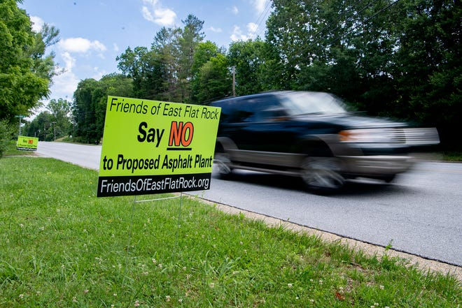 Signs opposing a new SE Asphalt drum plant line the side of the Spartanburg Highway across from the proposed site in East Flat Rock on June 12, 2020.