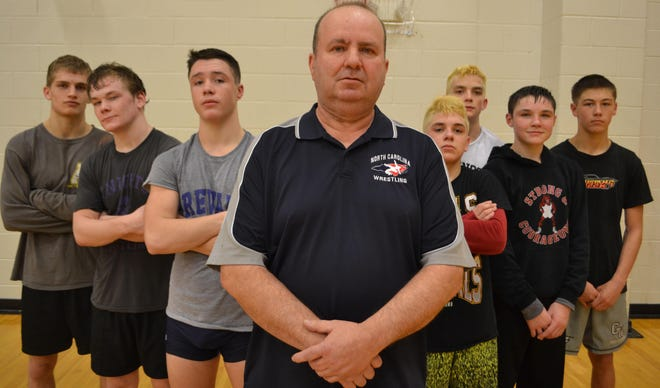 Strong and Courageous Club founder Norman Osteen poses with some of his wrestlers in this file photo.