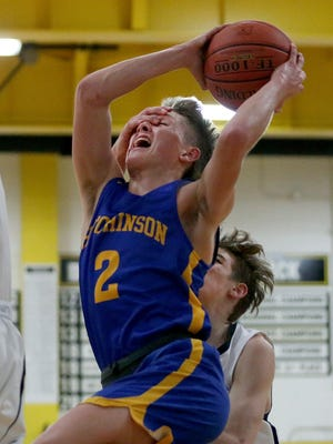 Hutchinson's Jake Huhs (2) drives to the basket as Campus' Aiden Sutter (0) covers his eyes during their Class 6A State quarterfinal game Monday night. Hutchinson was defeated by Campus 70-61.
