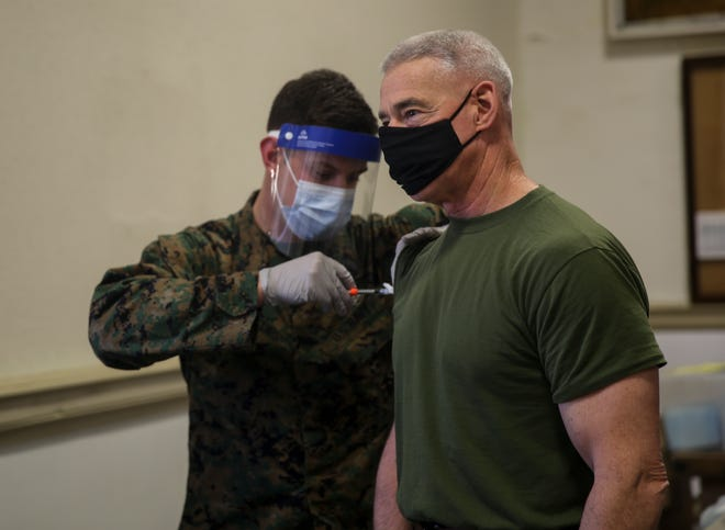 U.S. Marine Corps Lt. Gen. Brian D. Beaudreault, commanding general, II Marine Expeditionary Force, gets the COVID-19 vaccine on Camp Lejeune,  Jan. 20, 2021.