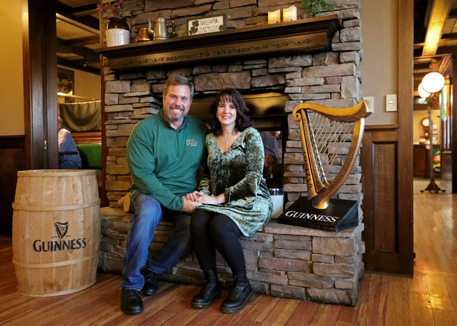 Mavis Winkle's Irish Pub owner Ed Hoegler and his wife Tammy pose for a portrait at their pub, which they bought in November 2019.