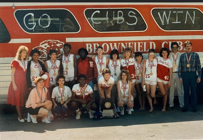 Members of the 1988 Brownfield girls basketball team pose for a photo after winning the Class 3A state championship. Many of the players from 1988 are traveling to San Antonio, where this year's Lady Cubs will play for the state championship for the first time since.