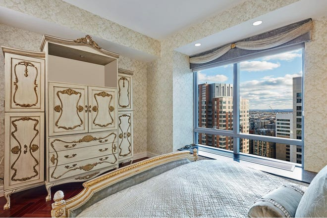"""Instead of the standard living-room introduction, this 1,573-square-foot unit's marble-floored foyer leads you straight into the primary bedroom suite, immediately answering your prayers to """"show me the way to go home, I'm tired and I want to go to bed."""""""