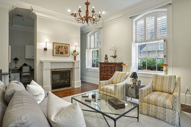 Oversized arched windows and an intricate brass chandelier emphasize the 11-foot ceiling height.