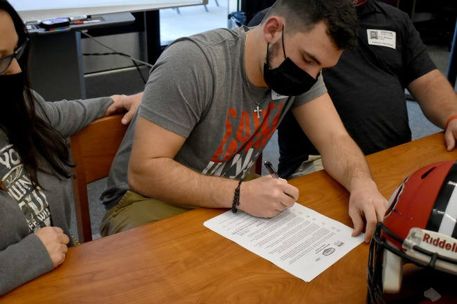 Kathleen linebacker Alex Bledsoe signs with Southeastern University to play football.