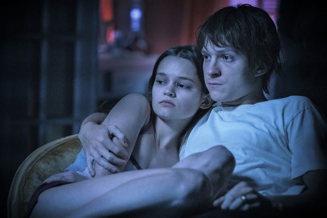 Emily (Ciara Bravo) and Cherry (Tom Holland) only have each other in dark times.