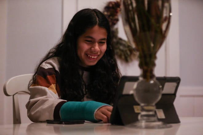 Eighth-grade student Kayla Fernandez participates in a Zoom presentation with Sophia Kressy, who previously worked at NASA, at her home in Upton, March 8, 2021. New England Innovation Academy in Marlborough hosted the event as part of International Women's Day.