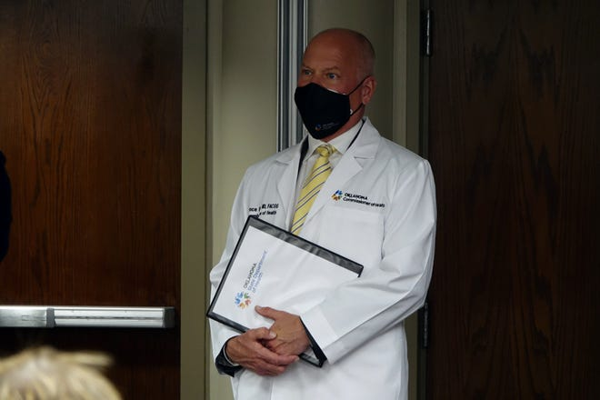 Oklahoma State Commissioner of Health Dr. Lance Frye prepares to speak at St. Ann's Skilled Nursing and Therapy on Tuesday. The state announced new guidelines for visiting long-term care facilities. [Addison Kliewer/The Oklahoman]