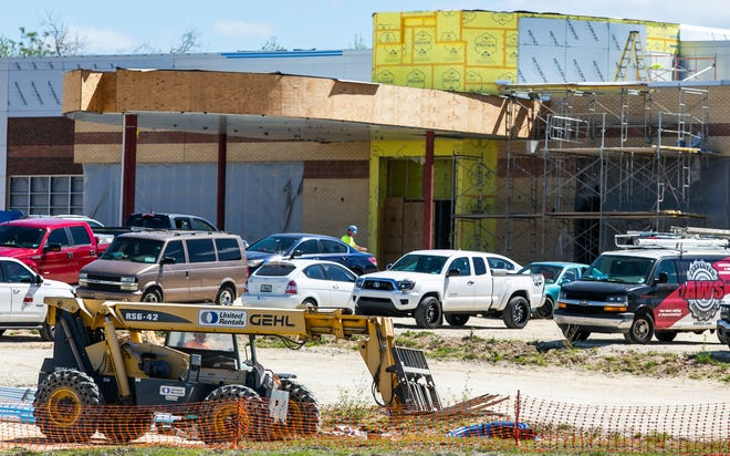 A construction worker hauls rebar on the site of the Ocala VA Outpatient Clinic on Tuesday. The clinic, 4826 SW 49th Road, Ocala, behind Bojangles and RaceTrac off State Road 200, will open in late summer.